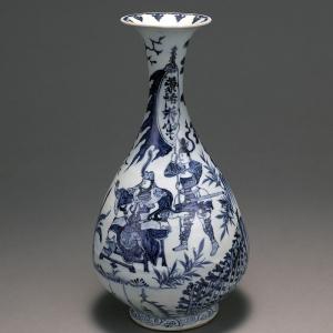 Vase sous forme de poire bleu et blanc avec lèvre évasée
