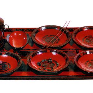 Dinnerware on a lacquer tray with cloud design